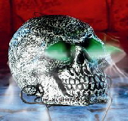 One of our skulls with glowing eyes emitting a spooky mis